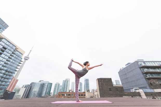 worm s eye view of woman doing yoga